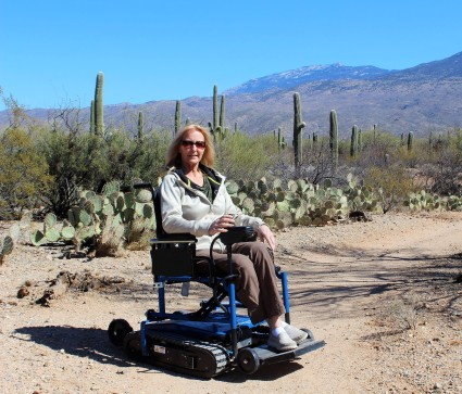 woman on Freedom Trax in the desert of Arizona with cactus around.