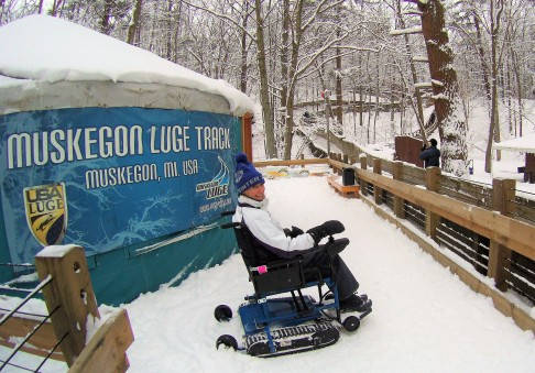 Esther watching the luge run at Muskegon Winter Sports Complex on Freedom Trax.
