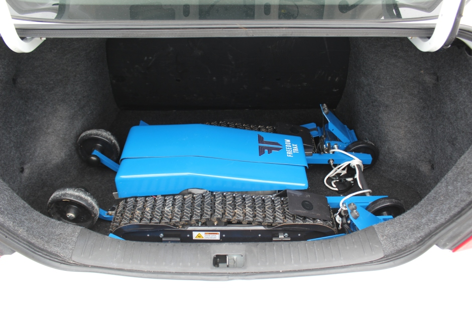 Freedom Trax in the trunk of a compact rental car
