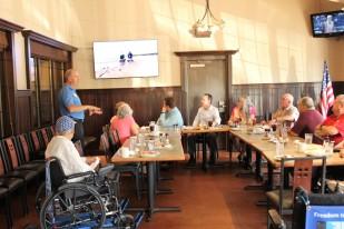 Chris doing a Freedom Trax presentation in front of the AMBUCs and Lori's voice board members.